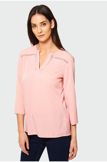 Pink blouse with hem