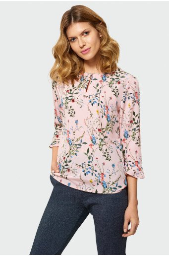 Elegant blouse with decorative flounces by the sleeves