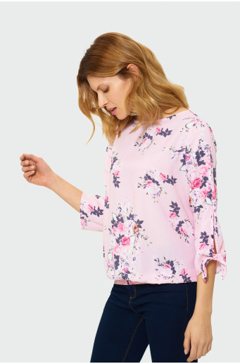 Blouse with bow on a sleeve