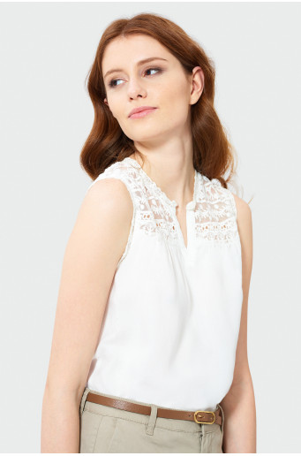White sleeveless blouse