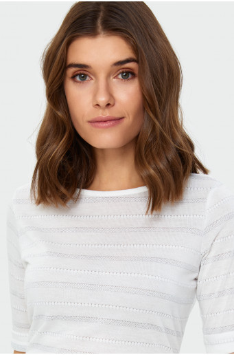 Skin-tight shimmering sweater